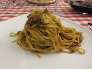 Little homemade tagliatelle with sauce made with tomato, chicken liver and sausage